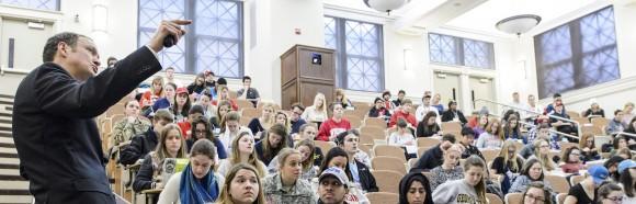 A professor lectures a classroom.