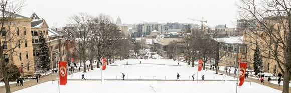 View from the top of a snow-covered Bascom Hill looking down to State Street